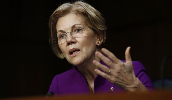 Senate Banking, Housing, and Urban Affairs Committee member Sen. Elizabeth Warren, D-Mass., questions Jerome Powell, President Donald Trump's nominee for chairman of the Federal Reserve, during a Senate Banking, Housing, and Urban Affairs Committee hearing on Capitol Hill in Washington, Tuesday, Nov. 28, 2017. (AP Photo/Carolyn Kaster)