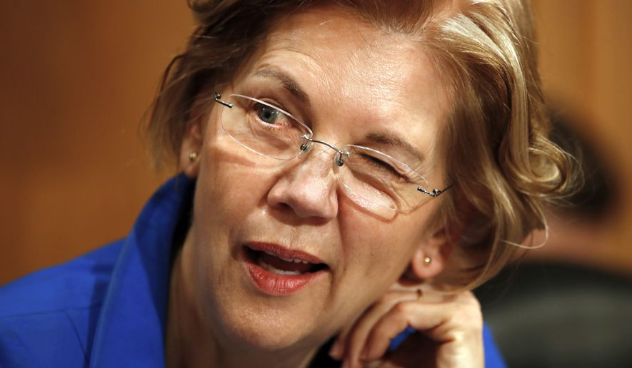 Sen. Elizabeth Warren, D-Mass., winks as she jokes with other senators on the Senate Banking Committee ahead of a hearing on the nomination of Marvin Goodfriend to be a member of the Federal Reserve Board of Governors, Tuesday, Jan. 23, 2018, on Capitol Hill in Washington. (AP Photo/Jacquelyn Martin)