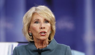 In this Feb. 22, 2018, file photo, Education Secretary Betsy DeVos speaks during the Conservative Political Action Conference (CPAC), at National Harbor, Md. (AP Photo/Jacquelyn Martin, File)