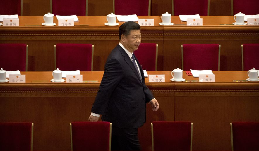 Chinese President Xi Jinping arrives for a plenary session of China's National People's Congress (NPC) at the Great Hall of the People in Beijing, Sunday, March 11, 2018. Many Western scholars who studied China believed that the opening to the outside world engineered by reformer Deng Xiaoping in the early 1980s would pave the way for corresponding political freedoms. That vision has been categorically shattered under President Xi Jinping, who many once thought would be the next great reformer. In just five years, Xi has consolidated more power than any Chinese leader since Mao Zedong and is now primed to rule as president-for-life. (AP Photo/Mark Schiefelbein)