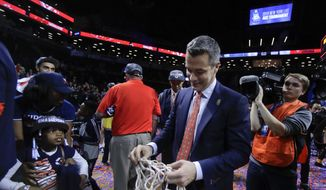 Virginia coach Tony Bennett walks off the floor with one of the nets after Virginia defeated North Carolina 71-63 in an NCAA college basketball game for the Atlantic Coast Conference men's tournament title Saturday, March 10, 2018, in New York. (AP Photo/Julie Jacobson) **FILE**
