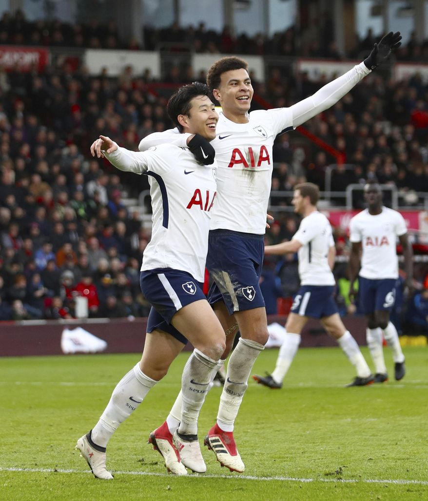 Tottenham Hotspur's Son Heung-Min, left, celebrates scoring his side's second goal of the game against Bournemouth with team mate Tottenham Hotspur's Dele Alli  during their English Premier League soccer match at the Vitality Stadium in Bournemouth, Sunday March 11, 2018. (John Walton/PA via AP)