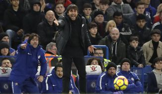 Chelsea head coach Antonio Conte, center, gestures during the English Premier League soccer match between Chelsea and Crystal Palace at Stamford Bridge stadium in London, Saturday, March 10, 2018. (AP Photo/Matt Dunham)