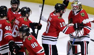 Chicago Blackhawks goalie Anton Forsberg, right, celebrates with center Jonathan Toews after the Blackhawks defeated the Boston Bruins 3-1 in an NHL hockey game Sunday, March 11, 2018, in Chicago. (AP Photo/Nam Y. Huh)