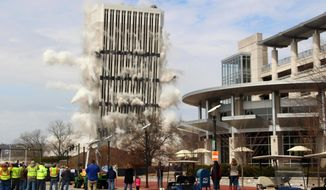 The 28-story Capital Plaza Tower falls during a controlled demolition in Frankfort, Ky., on Sunday, March 11, 2018. Built in 1972, the former state government office building was demolished to make way for a new five-story building and parking garage. (AP Photo/Adam Beam)