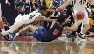 UC Irvine guard Evan Leonard (14) and Cal State Fullerton guard Kyle Allman Jr. (0) scramble for the ball during the first half of an NCAA college basketball game for the Big West men's tournament championship in Anaheim, Calif., Saturday, March 10, 2018. (AP Photo/Reed Saxon)