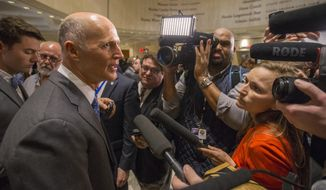 Florida Governor Rick Scott talks to the media at the end of the legislative session at the Florida State Capitol in Tallahassee, Fla., Sunday March 11, 2018. The ending of the legislative session in Florida is called Sine Die and is signaled with the ceremonial dropping of the handkerchief from the Florida House and Senate. (AP Photo/Mark Wallheiser)
