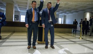 Russell Hosford, left, Sergeant at Arms of the Florida House and Tim Hay, Sergeant at Arms of the Florida Senate, drop the ceremonial handkerchiefs to signify Sine Die, or the end of the legislative session at the Florida State Capitol in Tallahassee, Fla., Sunday, March 11, 2018. (AP Photo/Mark Wallheiser)