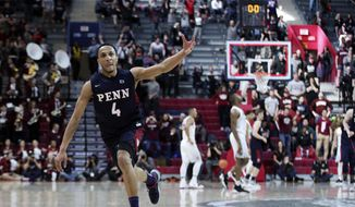 Pennsylvania's Darnell Foreman reacts to his three-point shot to end the first half of an NCAA college basketball championship game in the Ivy League Tournament against the Harvard, Sunday, March 11, 2018, in Philadelphia. (AP Photo/Chris Szagola)