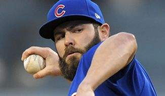 File-This may 26, 2017, file photo shows Chicago Cubs starting pitcher Jake Arrieta throwing to the plate during the first inning of a baseball game against the Los Angeles Dodgers, in Los Angeles. Two people familiar with the deal tell The Associated Press that free agent ace Arrieta and the Philadelphia Phillies have agreed to a three-year deal. Both people spoke to the AP on condition of anonymity Sunday because the contract is pending a physical. The deal is reportedly worth $75 million.(AP Photo/Mark J. Terrill, File) **FILE**