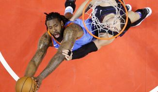 Los Angeles Clippers center DeAndre Jordan, left, reaches for a rebound along with Orlando Magic center Nikola Vucevic during the first half of an NBA basketball game, Saturday, March 10, 2018, in Los Angeles. (AP Photo/Mark J. Terrill)