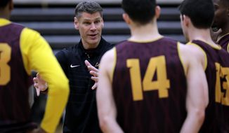 Loyola head coach Porter Moser talks to his team during NCAA college basketball practice in Chicago, Friday, March 9, 2018. Loyola locks up 1st March Madness appearance in 33 years. (AP Photo/Nam Y. Huh)
