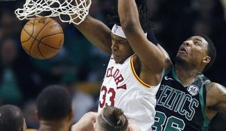 Indiana Pacers' Myles Turner (33) dunks in front of Boston Celtics' Marcus Smart (36) during the first quarter of an NBA basketball game in Boston, Sunday, March 11, 2018. (AP Photo/Michael Dwyer)