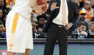 Tennessee head coach Rick Barnes, right, directs his players during the first half of an NCAA college basketball championship game against Kentucky at the Southeastern Conference tournament Sunday, March 11, 2018, in St. Louis. (AP Photo/Jeff Roberson)