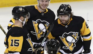 Pittsburgh Penguins' Jamie Oleksiak (6) celebrates his goal with Phil Kessel (81) Riley Sheahan (15) and Justin Schultz (4) in the first period of an NHL hockey game against the Dallas Stars in Pittsburgh, Sunday, March 11, 2018. (AP Photo/Gene J. Puskar)