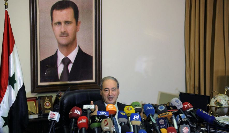 "This photo released by the Syrian official news agency SANA, Syrian Deputy Foreign Minister Faisal Mekdad, speaks during a news conference in Damascus, Syria, Saturday, March 10, 2018. Mekdad denied opposition charges that government forces used poison gas in their attacks on eastern Ghouta. Mekdad added that insurgents groups in the eastern Ghouta are preparing ""to fabricate"" more such attacks to blame the Syrian army. (SANA via AP)"