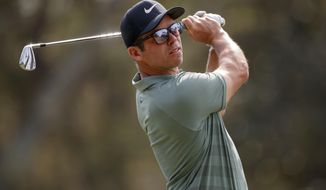 Paul Casey tees off on the 17th hole during the final round of the Valspar Championship golf tournament Sunday, March 11, 2018, in Palm Harbor, Fla. (AP Photo/Mike Carlson)