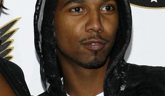 FILE - In this Oct. 2, 2008 file photo, Juelz Santana arrives at the VH1 Hip Hop Honors in New York. Authorities say Juelz Santana turned himself into Port Authority Police early Monday  after a gun was found in a carry-on bag containing his identification at a New York City area airport last week. He is due to appear in U.S. District Court in Newark later in the day. (AP Photo/Jason DeCrow, File)