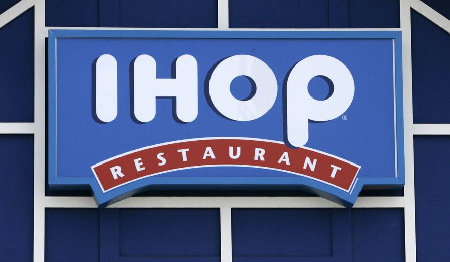 In this July 16, 2007, file photo, an IHOP restaurant sign is shown in Burbank, Calif. (AP Photo/Nick Ut, File)