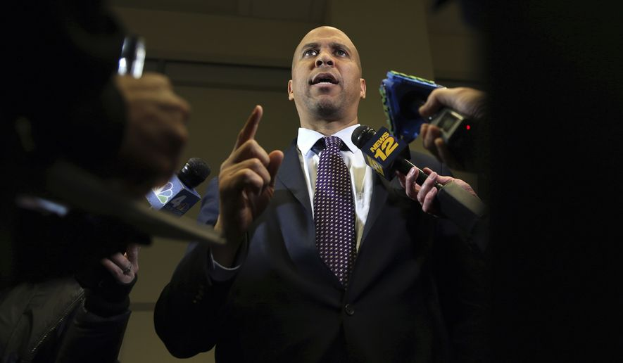 Sen. Cory Booker, D-NJ, answers a question Monday, Dec. 11, 2017, in Newark, N.J. Earlier Booker along with fellow Senator Bob Melendez, D-NJ, and New Jersey Governor-elect Phil Murphy, who replaces Gov. Chris Christie on Jan. 16, discussed how they can work together when Murphy takes office next month. (AP Photo/Mel Evans)