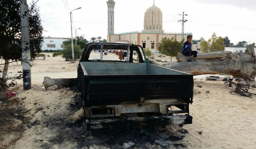 A burned truck is seen outside Al-Rawda Mosque in Bir al-Abd northern Sinai, Egypt a day after attackers killed hundreds of worshippers. Egypt's military says it has begun a major security operation in areas including the restive northern Sinai Peninsula, where Islamic militants are most active. (AP Photo/Tarek Samy, File)