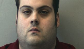 This booking photo released Thursday, March 1, 2018, by the Beverly Police Department shows Daniel Frisiello, of Beverly, Mass., accused of mailing five envelopes earlier this month with threatening messages and a white substance, including one to Donald Trump Jr., that landed his wife, Vanessa, in the hospital. Frisiello was held after an appearance Thursday in federal court in Worcester pending a detention hearing scheduled for Monday. (Beverly Police Department via AP)