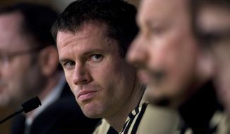 FILE - This is a Tuesday, Feb. 24, 2009 file photo of  Liverpool's Jamie Carragher as he listens to a question during a press conference ahead of a Champions League, Round of 16, first leg soccer match against Real Madrid at the Santiago Bernabeu Stadium in Madrid. The Sky television network Monday March 12, 2018 suspended soccer announcer Jamie Carragher after the former Liverpool player was filmed spitting in the direction of a 14-year-old girl through his car window. The incident happened Saturday after Carragher left Old Trafford. He had been there working for Sky Sports at Manchester United's game against Liverpool. (AP Photo/Arturo Rodriguez/File)