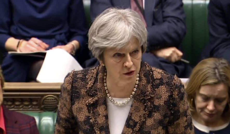 "Britain's Prime Minister Theresa May speaks in the House of Commons in London, Monday, March 12, 2018. British Prime Minister Theresa May says her government has concluded it is ""highly likely"" Russia is responsible for the poisoning of an ex-spy and his daughter. May told British lawmakers on Monday that Sergei Skripal and his daughter, Yulia, were exposed to a nerve agent known as Novichok (Novice), a weapon developed in the Soviet Union in the end of the Cold War. (PA via AP)"