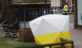 "A police tent covers the the spot where former Russian double agent Sergei Skripal and his daughter Yulia were found critically ill following exposure to a ""nerve agent substance"" in Salisbury, England, Monday, March 12, 2018. (AP Photo/Frank Augstein)"