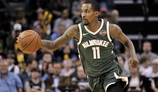 Milwaukee Bucks guard Brandon Jennings (11) brings the ball upcourt in the first half of an NBA basketball game against the Memphis Grizzlies, Monday, March 12, 2018, in Memphis, Tenn. (AP Photo/Brandon Dill)