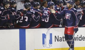 Columbus Blue Jackets' Seth Jones, right, celebrates his goal against the Montreal Canadiens during the first period of an NHL hockey game Monday, March 12, 2018, in Columbus, Ohio. (AP Photo/Jay LaPrete)