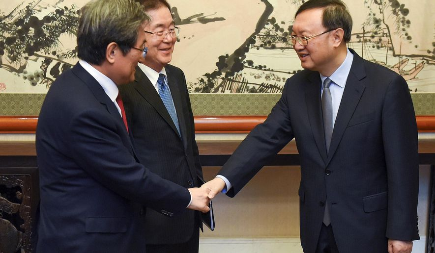 Chinese State Councilor Yang Jiechi, right, meets with South Korea's national security director Chung Eui-yong, center, and South Korean ambassador to China Noh Young-min at the Diaoyutai State Guesthouse in Beijing Monday, March 12, 2018. (Etienne Oliveau/Pool Photo via AP)