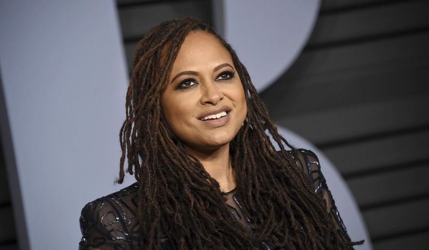 "FILE - In this March 4, 2018, file photo, Ava DuVernay arrives at the Vanity Fair Oscar Party in Beverly Hills, Calif. DuVernay is scheduled to be a guest at the 20th annual Ebertfest in Champaign, Ill. The University of Illinois said Monday, March 12, 2018, that the Oscar-nominated director of ""Selma"" and ""A Wrinkle in Time"" will attend the film festival, which honors the late Chicago Sun-Times movie critic Roger Ebert. (Photo by Evan Agostini/Invision/AP, File)"