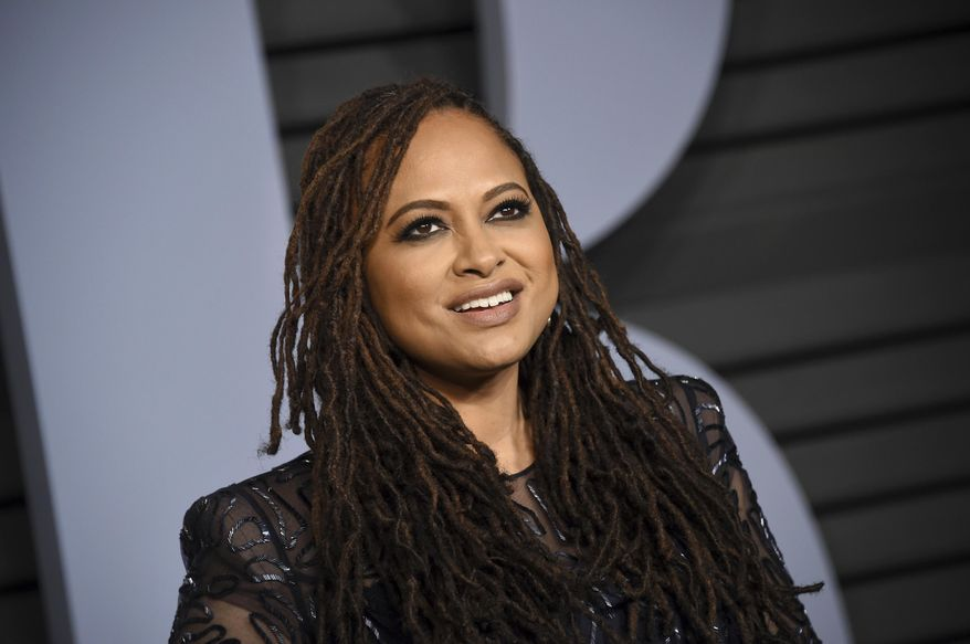 """FILE - In this March 4, 2018, file photo, Ava DuVernay arrives at the Vanity Fair Oscar Party in Beverly Hills, Calif. DuVernay is scheduled to be a guest at the 20th annual Ebertfest in Champaign, Ill. The University of Illinois said Monday, March 12, 2018, that the Oscar-nominated director of """"Selma"""" and """"A Wrinkle in Time"""" will attend the film festival, which honors the late Chicago Sun-Times movie critic Roger Ebert. (Photo by Evan Agostini/Invision/AP, File)"""