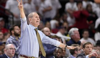 FILE - In this Feb. 24, 2018, file photo, Michigan head coach John Beilein gestures during the second half of an NCAA college basketball game against Maryland in College Park, Md. Beilein has stood the test of time in basketball, coaching since the mid-1970s and earning one of the best reputations in the game as a teacher and a man of integrity. (AP Photo/Nick Wass, File)