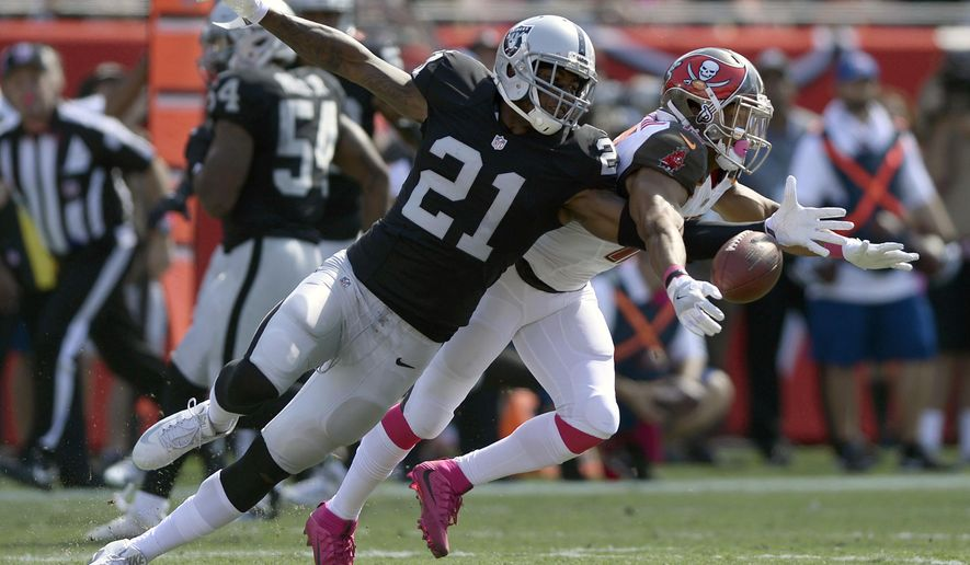 FILE - In this Oct. 30, 2016, file photo,Oakland Raiders cornerback Sean Smith (21) breaks up a pass intended for Tampa Bay Buccaneers wide receiver Cecil Shorts (10) during the first quarter of an NFL football game, in Tampa, Fla. The Raiders are releasing cornerback Sean Smith to create more salary cap room heading into free agency. A person familiar with the move said Smith was told Monday, March 12, 2018, that he will be let go before the start of the new league year on Wednesday. The person spoke on condition of anonymity because the team hadn't announced the move. (AP Photo/Jason Behnken, File)