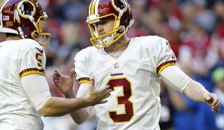FILE - In this Dec. 4, 2016 file photo, Washington Redskins kicker Dustin Hopkins (3) celebrates his field goal with punter Tress Way (5) holds during the first half of an NFL football game against the Arizona Cardinals in Glendale, Ariz.  The Redskins announced today that they have re-signed Hopkins.  (AP Photo/Ross D. Franklin)