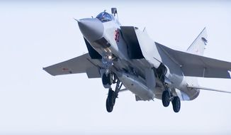 In this photo made from the footage taken from Russian Defense Ministry official web site on Sunday, March 11, 2018, a MiG-31 fighter jet of the Russian air force carrying the new Kinzhal hypersonic missile takes off from an air base in southern Russia.  The Russian military says it has run a successful test of the Kinzhal missile, that President Vladimir Putin sited among several other new nuclear weapons that would bolster the nation's military capability. (AP Photo/ Russian Defense Ministry Press Service, File)