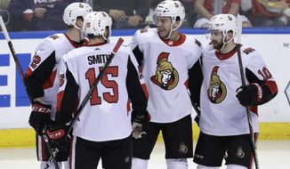 Ottawa Senators' Magnus Paajarvi, second from right, celebrates his goal with Zack Smith (15) and Tom Pyatt (10) during the third period of an NHL hockey game against the Florida Panthers, Monday, March 12, 2018, in Sunrise, Fla. (AP Photo/Lynne Sladky)