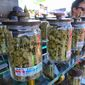 Cannabis industry analysts are now praising President Trump's controversial tax reform as a major break for cannabis retailers. (Associated Press)