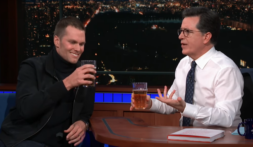 "Tom Brady appears as a guest on ""The Late Show with Stephen Colbert"" Monday, March 12, 2018, where the five-time Super Bowl-winning quarterback broke his diet to beat Colbert in a beer-chugging contest. (Screenshot from YouTube/The Late Show with Stephen Colbert)"