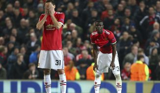 Manchester United's Nemanja Matic reacts after Sevilla scored their second goal of the game as he waits for the restart during the Champions League round of 16 second leg soccer match between Manchester United and Sevilla, at Old Trafford in Manchester, England, Tuesday, March 13, 2018. (AP Photo/Dave Thompson)