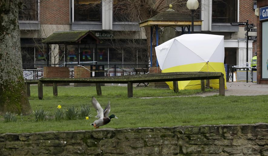 A police tent covers the area where former Russian double agent Sergei Skripal and his daughter & The Latest: Russia warns UK over ultimatums points at nukes ...