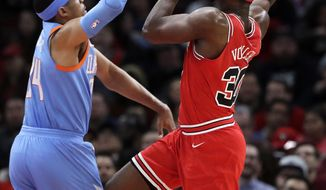 Chicago Bulls forward Noah Vonleh, right, shoots against Los Angeles Clippers forward Tobias Harris during the first half of an NBA basketball game, Tuesday, March 13, 2018, in Chicago. (AP Photo/Nam Y. Huh)