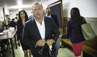 """FILE - In this April 17, 2017, file photo, """"Infowars"""" host Alex Jones arrives at the Travis County Courthouse in Austin, Texas. Brennan Gilmore, a former State Department official who became the target of harassment after posting a video showing the car attack during a white nationalist rally in Charlottesville, is suing right-wing conspiracy theorist Alex Jones and others. Gilmore's defamation lawsuit was filed Tuesday, March 13, 2018, in federal court in Charlottesville, Va. (Tamir Kalifa/Austin American-Statesman via AP, File)/Austin American-Statesman via AP)"""