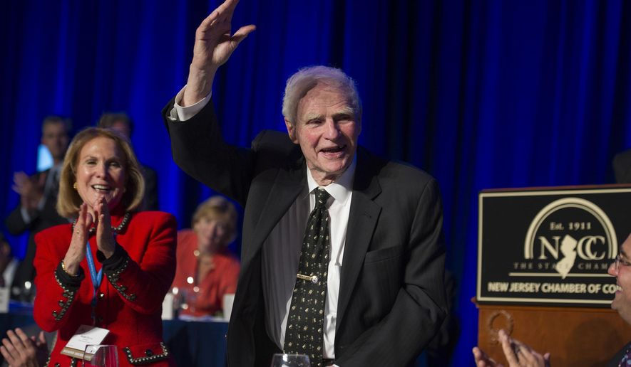 """FILE – In this April 22, 2014, file photo, former New Jersey Gov. Brendan Byrne waves as the audience sings him """"Happy Birthday"""" and his wife Ruthi Zinn Byrne applauds, to mark his 90th birthday during the annual """"Congressional Dinner"""" of the New Jersey State Chamber of Commerce in Washington, D.C. A ceremony at Healy's Tavern in Jersey City on Friday, March 16, 2018, will honor Byrne, who died in January at age 93. Byrne used to joke he wanted his ashes placed in Hudson County, known for its history of political shenanigans, so he could stay active in politics. (AP Photo/Cliff Owen, File)"""