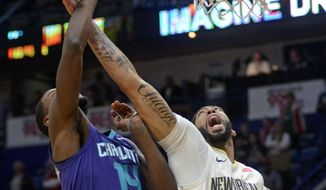 Charlotte Hornets forward Michael Kidd-Gilchrist (14) shoots the ball against New Orleans Pelicans forward Anthony Davis (23) in the first half of an NBA basketball game in New Orleans, Tuesday, March. 13, 2018. (AP Photo/Veronica Dominach)