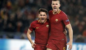 Roma's Edin Dzeko, right, celebrates with his teammate Cengiz Under after scoring  after scoring his side's opening goal during a Champions League round of 16 second-leg soccer match between Roma and Shakhtar Donetsk, at the Rome Olympic stadium, Tuesday, March 13, 2018. (Riccardo Antimiani/ANSA via AP)