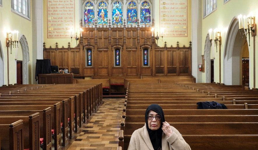 Saheeda Perveen Nadeem sits in the First Congregational Church, United Church of Christ, in downtown Kalamazoo, Mich., on Monday, March 12, 2018, the day she was scheduled for deportation by Immigration and Customs Enforcement. The church has offered sanctuary to the Pakistani who has lived in the U.S. for 13 years and who's 20-year-old son is protected under the Deferred Action for Childhood Arrivals program. (Mark Bugnaski /Kalamazoo Gazette-MLive Media Group via AP)