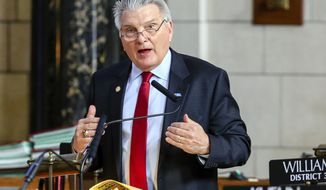 State Sen. John Stinner of Gering, the Appropriations Committee chairman, speaks during debate in Lincoln, Neb., Tuesday, March 13, 2018, on a proposed $8.8 billion, two-year budget. (AP Photo/Nati Harnik)